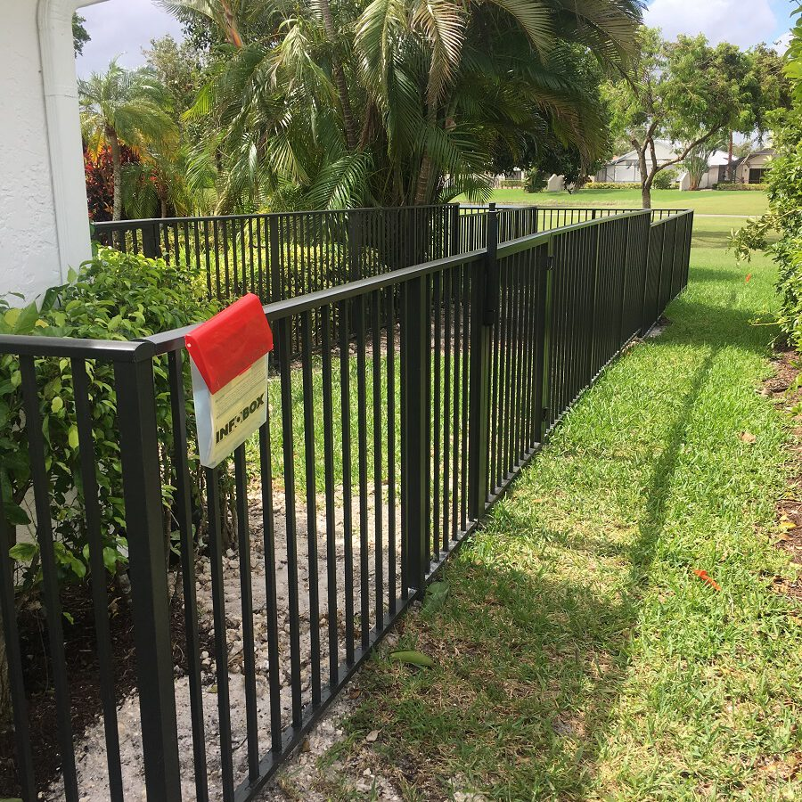A new black iron fence installation in Wichita Falls
